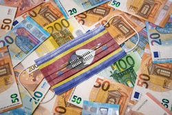 A surgical mask with the flag of Swaziland on a variety of european banknotes.(series)