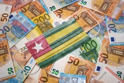 A surgical mask with the flag of Togo on a variety of european banknotes.(series)