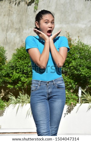 A Surprised Youthful Filipina Female