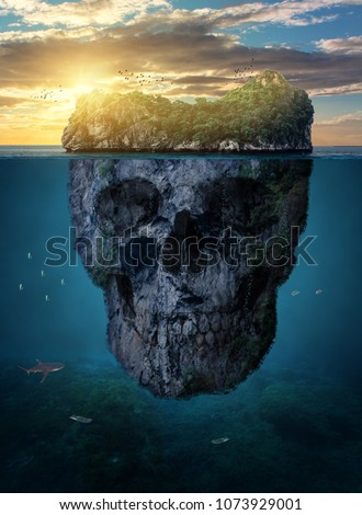 Stock Photo a surreal sea rock with a skull and an island in the middle of the ocean