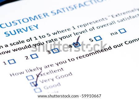 A survey questionnaire for customer satisfaction with checkboxes - stock photo