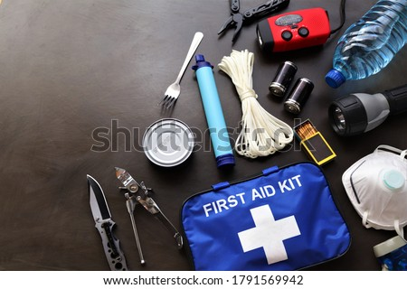 A survival kit is useful to have in the event of an emergency such as floods,fires,earthquakes,hurricanes and other natural disasters.These items can be placed in a bag prepared and ready to go  Photo stock ©