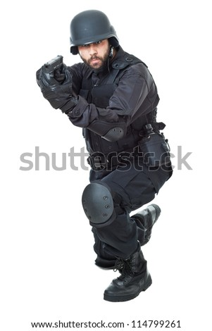 a swat agent wearing a bulletproof vest and aiming with a gun