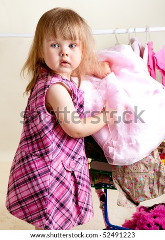 A sweet girl buying dresses and tops