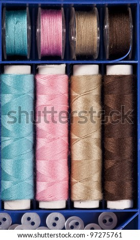 A sweing set with different colors of fine thread - stock photo
