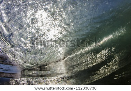 a swimmers view inside an ocean wave.