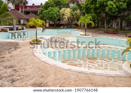 A swimming pool empties at the end of tourist season Stock fotó ©