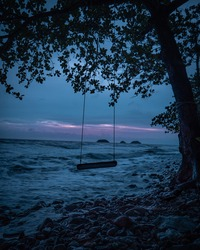 A swing on the beach at night in Koh Chang Island