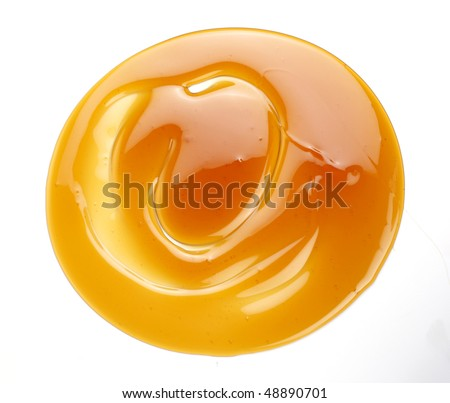 a swirl of honey drop - stock photo