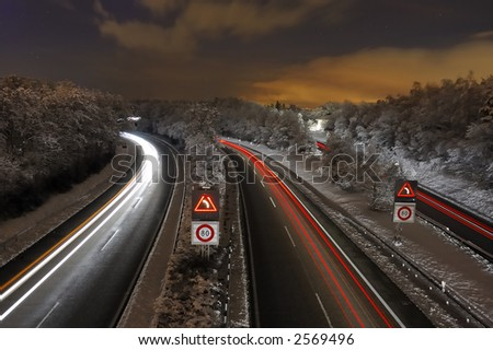 A Swiss freeway (autoroute) at night, after a fall of snow.