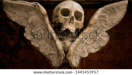 A symbole of skull and Wings in a 1600 tombstone at Santa Maria Church in Rieti, Italy. Meaning of the symbol is victory over the death. #1445453957