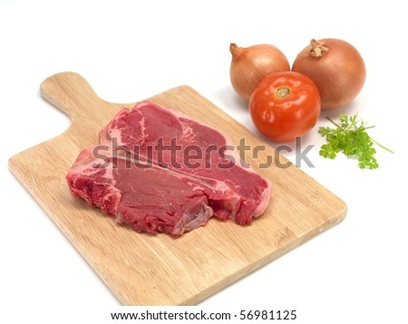 A T Bone steak isolated against a white background