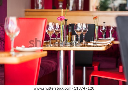 A table plated for four people at the most.