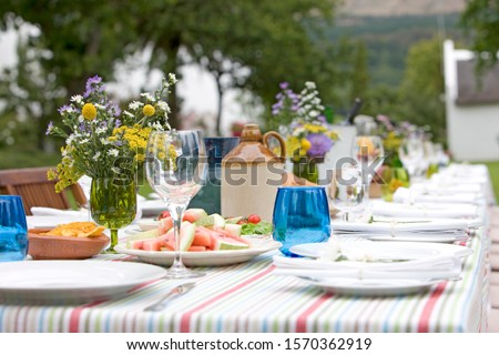 Fototapete A table set for a summer garden party, close-up