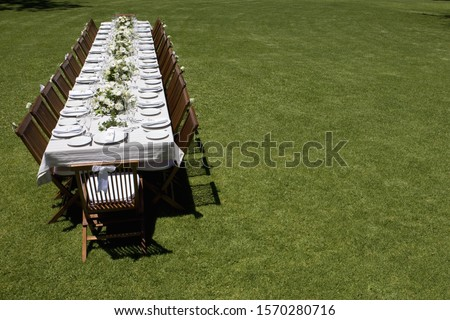 A table set for a wedding outdoors