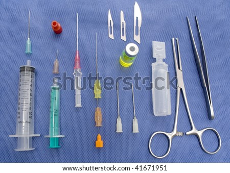 A table with a set of many surgical equipment