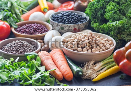 A table with bowls of beans and mixed vegetables #373355362