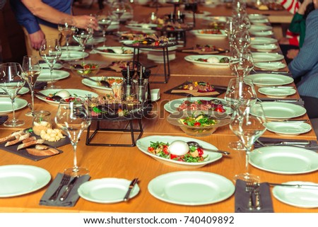 A table with plates and food for a big company #740409892