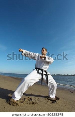 A taekwondo fighter at the beach