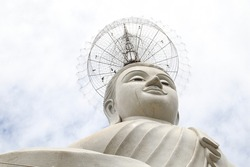 A tall Buddha statue towering.