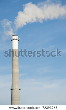 A Tall Smoke Stack Releasing Pollution into the Sky
