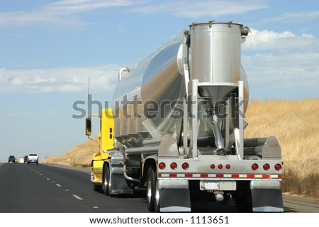 A tanker truck transports some type of liquid to who knows where.