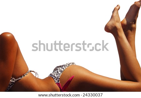 A tanning woman's body frames the copy space.  Isolated with clipping path.