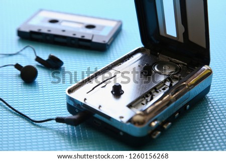 A tape cassette player on a blue background. Music playback concept image.