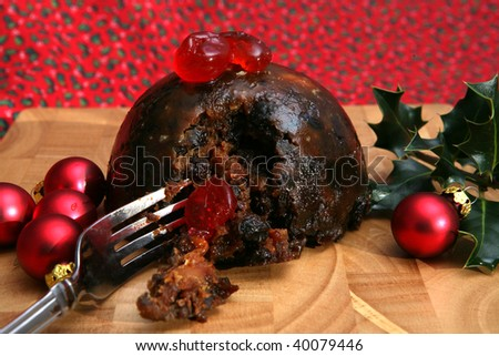 A tasty Christmas Pudding with Cherries and Baubles