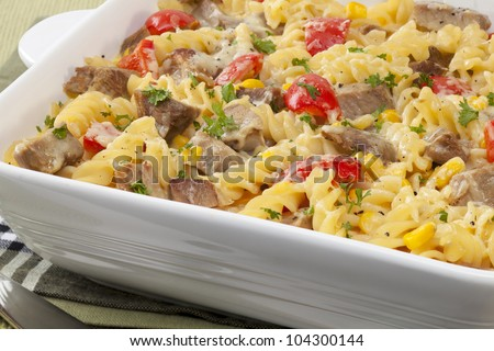 A tasty way of using up leftover roast meat, this pasta bake includes pork, red pepper, corn and melting cheese.