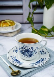 A tea time with a snack is happy after hectic day. A close up, bright, shiny and blurry background
