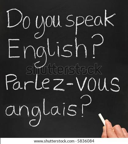 A teacher writing do you speak english in French.