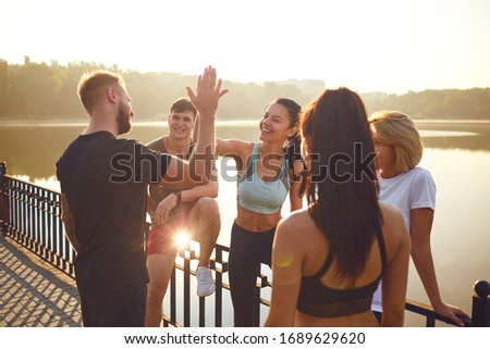 A team of athletes training together. stock photo