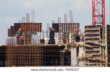 A team of builders at work on a construction site