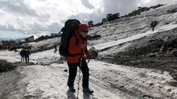 A team of climbers ascending an icy slope on Mt. Everest across the sky above. Clip. People enjoying climbing a snowy path.