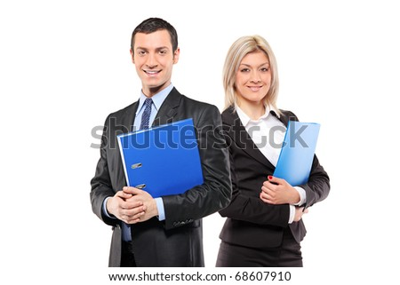 A team of happy businesspeople holding a fascicule with documents isolated on white background