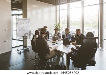 A team of young businessmen working and communicating together in an office. Corporate businessteam and manager in a meeting. #1445086202