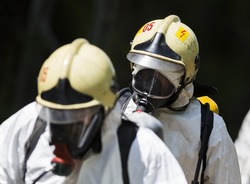 A team working with toxic acids and chemicals is approaching a chemical cargo train crash near Sofia, Bulgaria. Teams from Fire department are participating in a training with spilled toxic materials.