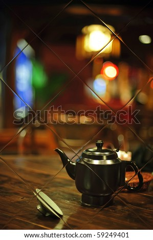 a teapot in mirror with colorful background