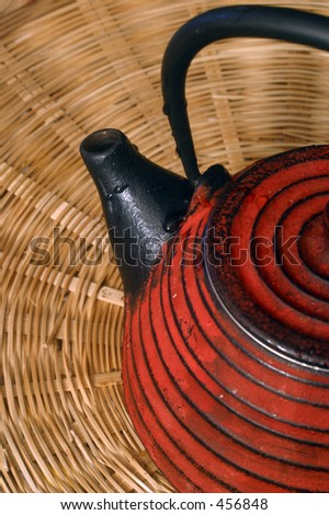 a teapot on a bamboo screen
