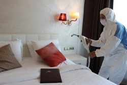 a technician is sanitizing an hotel room in Prague, using steam and ozone,  after the coronavirus SARS-CoV-2 COVID-19 pandemic