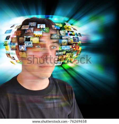 A technology man has images around his head with an abstract glow. Use it for a communication or tv concept.