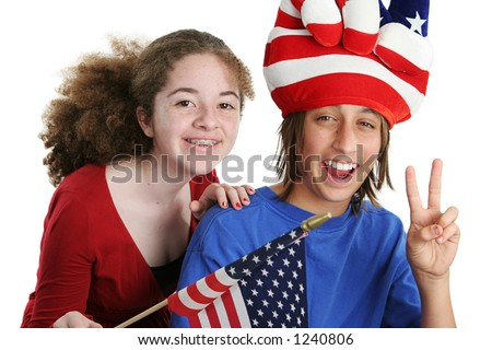 A teen boy and girl wearing a patriotic hat and waving an American flag at school or watching a parade go by.