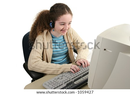 A teen girl smiling as she surfs the internet.