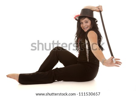 A teen girl with a smile on her face holding her cane behind her back with a smile on her face.