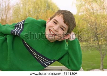 A teenage boy with a big smile