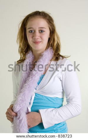 stock photo : A teenage girl models her new scarf. Save to a lightbox ▼