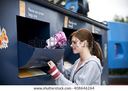 A teenage girl recycling clothes