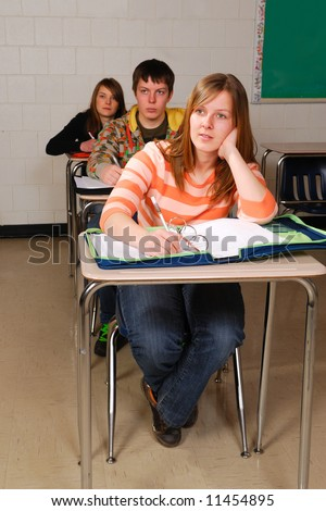 A teenage student listens in high school class