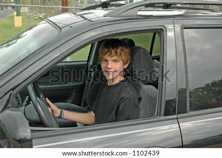 A teenaged boy drives his parent's sports utility vehicle